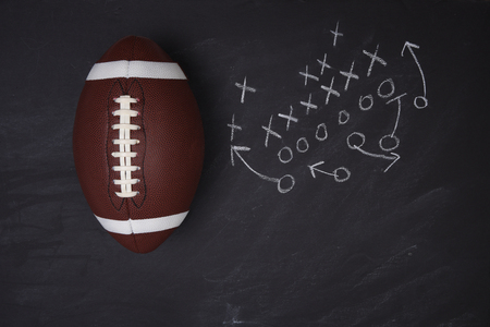 American College Football and play diagram on a chalkboard. Top view with copy space.