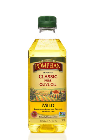 IRVINE, CALIFORNIA - APRIL 15, 22019: Pompeian Olive Oil.  The oil is naturally Cholesterol free and Non-GMO.