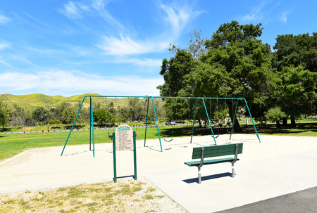 ORANGE, CALIFORNIA - APRIL 18, 2019: Playground area with swing set at the Irvine Regional Park in Orange County , California.