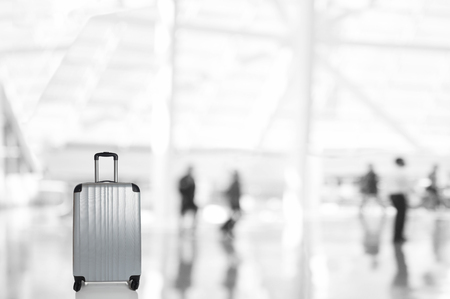 An Unattended Bag with Blurred Travelers in Airport Concourse or Railway Station.