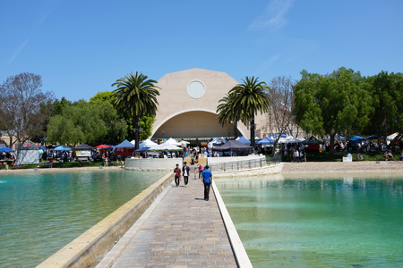 ALISO VIEJO, CALIFORNIA, MAY 4, 2019: Walkway bisecting Peace Lake at Soka University during the 18th annual International Festival.