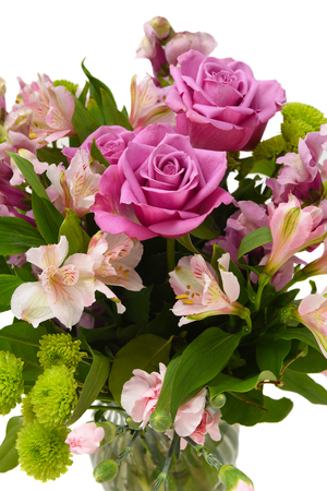 Closeup of a beautiful floral arrangement for Mothers Day or Valentines in a glass vase isolated on white. Archivio Fotografico
