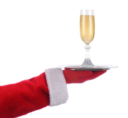 Santa Claus holding a serving tray with a glass of champagne over a white background.