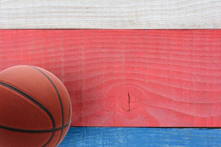 High angle shot of a basketball on a red, white and blue picnic table. Horizontal format with copy space. Suitable for American Holidays: 4th of July and Memorial Day, 写真素材