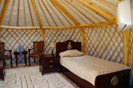 KARAKORUM, MONGOLIA - June 29, 2006: Interior of a yurt at the Urguu Ger Camp in Mongolias Gobi Desert. Editorial