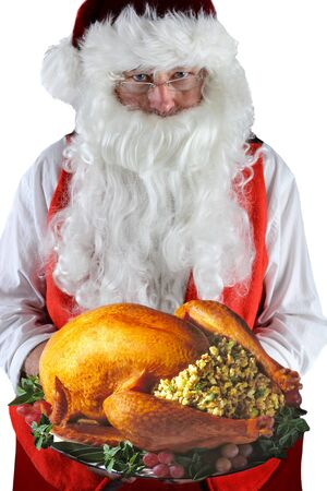 Santa Claus serving a fresh Roasted Thanksgiving or Christmas Turkey with all the trimmings. Stock fotó