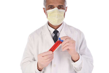 Laboratory Technician holding a vial of red liquid in front of his body. Man is wearing a protective mask to prevent infection.