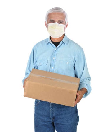 Package deliveryman wearing protective covid-19 mask with a single parcel isolated over white.