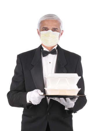 Butler in tuxedo wearing a covid-19 protective face mask holding a take-out food containers on a tray, isolated over white