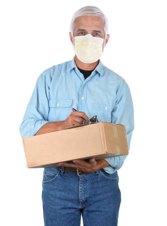 Deliveryman wearing a covid-19 protective mask with package and clipboard isolated on white.