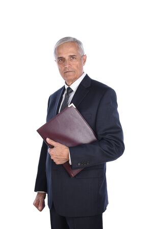 Portrait of a serious mature businessman isolated on white. Man is holding a folder under his arm.