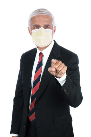 A middle aged businessman wearing covid-19 protective mask and  pointing at the viewer. Vertical format isolated on white. Stockfoto