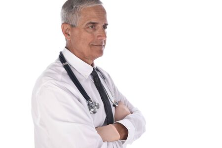 Profile portrait of a mature doctor in white shirt and tie with his arms folded and a stethoscope around his neck.