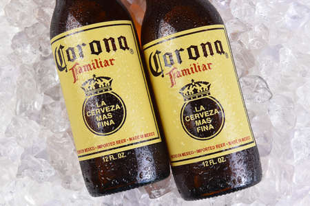 IRVINE, CALIFORNIA - MARCH 21, 2018: Two Corona Familiar beer bottles on ice. Familiar tastes like Corona Extra, but with a richer flavor.