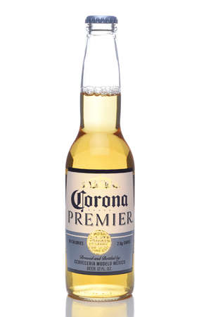 IRVINE, CALIFORNIA - 12 JUNE 2020: A single bottle of Corona Premier beer isolated on white with reflection.
