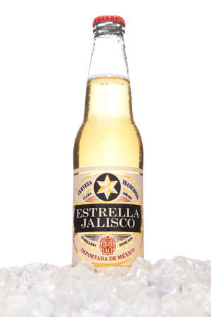 IRVINE, CALIFORNIA - MARCH 21, 2018: A bottle of Estrella Jalisco Beer in ice. Estrella Jalisco is a American Lager style beer brewed by Grupo Modelo.