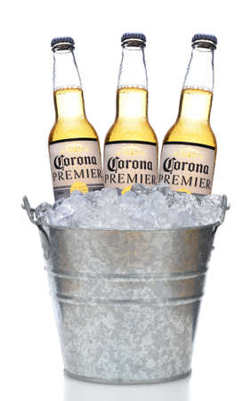IRVINE, CALIFORNIA - MARCH 21, 2018:  Three Corona Premier Bottles in an Ice Bucket with Condensation isolated on white vertical composition with reflection Redactioneel