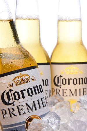 IRVINE, CALIFORNIA - MARCH 29, 2018: Closeup of three Corna Premier beer bottles in ice. Corona Premier is premium light beer with 2.6 grams of carbs and 90 calories.