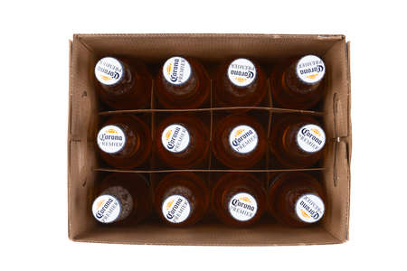 IRVINE, CALIFORNIA - 10 MAR 2020: High angle shot of a 12 pack of Corona Premier bottles with lid off the box. Redactioneel