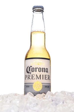 IRVINE, CALIFORNIA - MARCH 21, 2018:  A bottle of Corona Premier in ice. Corona Premier is premium light beer with 2.6 grams of carbs and 90 calories.