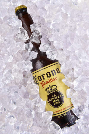 IRVINE, CALIFORNIA - MARCH 29, 2018: Closeup of a Corona Familiar beer bottle in ice. Familiar tastes like Corona Extra, but with a richer flavor.