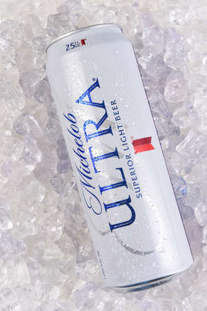 IRVINE, CALIFORNIA - MARCH 21, 2018: A 25 ounce can of Michelob Ultra Beer on ice. A a low carb and low calorie light beer from Anheuser-Busch.