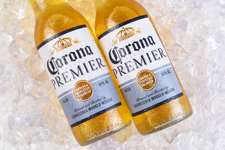 IRVINE, CALIFORNIA - MARCH 21, 2018:  Two bottles of Corona Premier on ice. Corona Premier is premium light beer with 2.6 grams of carbs and 90 calories.