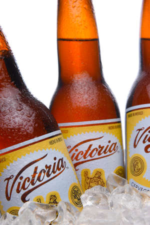 IRVINE, CALIFORNIA - MARCH 29, 2018: Closeup of three  bottles of Victoria Beer in ice. Mexicos oldest beer brand. Victoria has been brewed consistently as a Vienna style lager for 145 years.