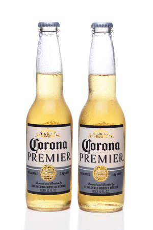 IRVINE, CALIFORNIA - 12 JUNE 2020: Two cold bottles of Corona Premier beer with condensation isolated on white with reflection.