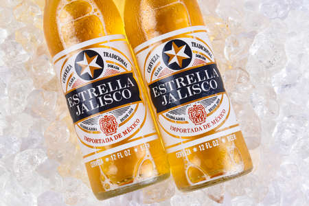 IRVINE, CALIFORNIA - MARCH 21, 2018: Two bottles of Estrella Jalisco Beer in ice closeup. Estrella Jalisco is a American Lager style beer brewed by Grupo Modelo.