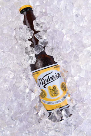 IRVINE, CALIFORNIA - MARCH 29, 2018: Closeup of a  bottle of Victoria Beer in ice. Mexicos oldest beer brand. Victoria has been brewed consistently as a Vienna style lager for 145 years.