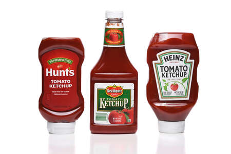 IRVINE, CALIFORNIA - 09 AUG 2020: Three bottles of the most popular Ketchups, Heinz, Hunts, and Del Monte