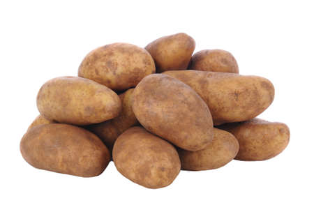Closeup of a pile of russet potatoes isolated on white.
