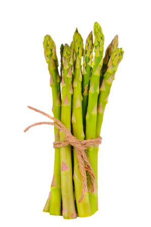 A bunch of fresh asparagus spears tied with twine isolated white Stockfoto