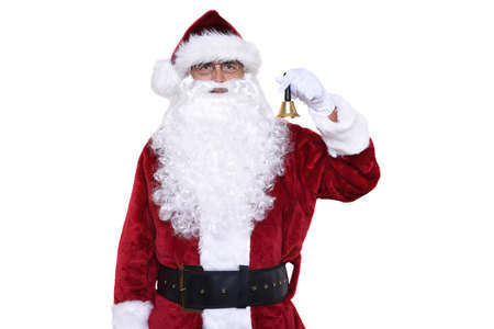 Senior man wearing a traditional Sant Claus costume holding a a gold bell ringing in Christmas. Foto de archivo