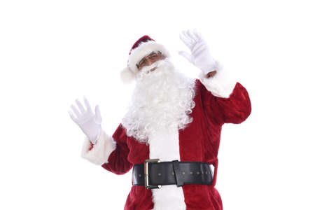 Senior man in traditional Santa Claus costume with hands in the air acting surprised or shocked. Isolated on white.