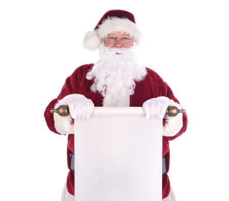 Santa Claus holding a scroll of paper in front of his body. The paper is blank with room for your copy.