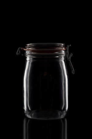 A glass canning jar isolated on black with reflection. Stockfoto