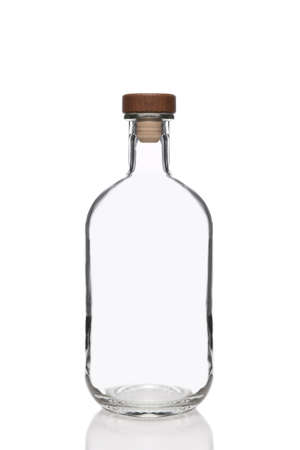 Clear Glass Bottle with cork stopper isolated on white