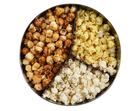 Three different styles of popcorn, buttered, cheese, and caramel, in a round tin. High angle isolated on white. Stockfoto