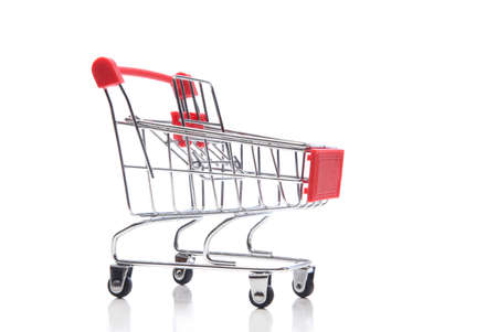 A supermarket shopping cart isolated on white.