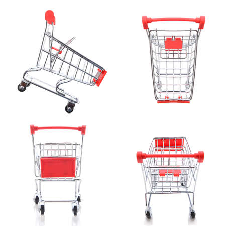 Four views, top, side, back and front, of a supermarket shopping cart isolated on white.