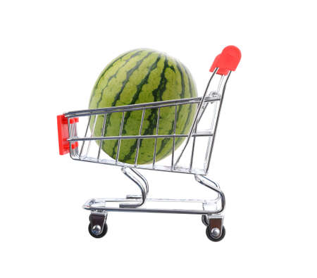 A watermelon filling a grocery store shopping cart. Isolated on white. Stockfoto
