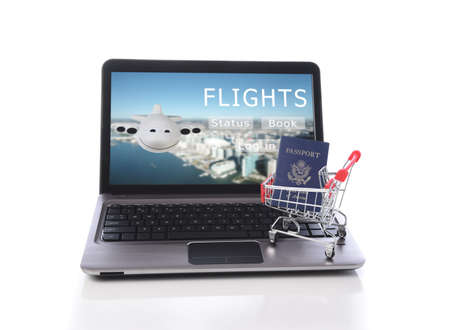 Online Travel Booking Concept. A laptop computer with a shopping cart and passport on a travel booking site.