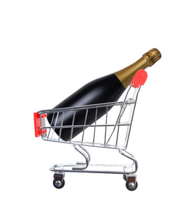 A Champagne bottle inside a grocery store shopping cart, isolated on white. Stockfoto
