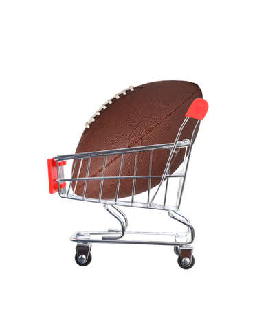 An American Football inside a grocery store shopping cart, isolated on white.