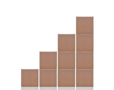 Business Concept: Stacked Cardboard boxes forming a bar graph, isolated on white.