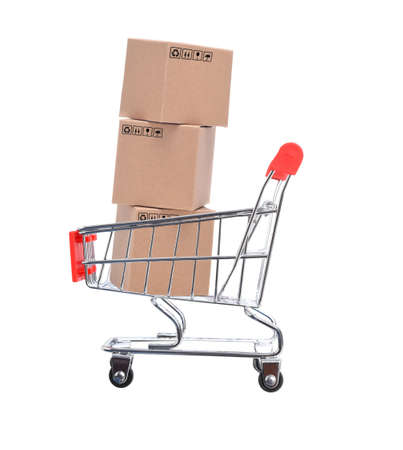 Three Cardboard Boxes inside a shopping cart, isolated on white.