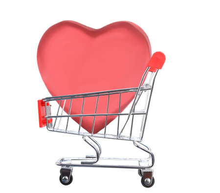 Valentines Day Concept. A large heart shaped candy box inside a grocery shopping cart, isolated on white.