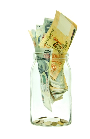 Singapore money in a jar Stock Photo